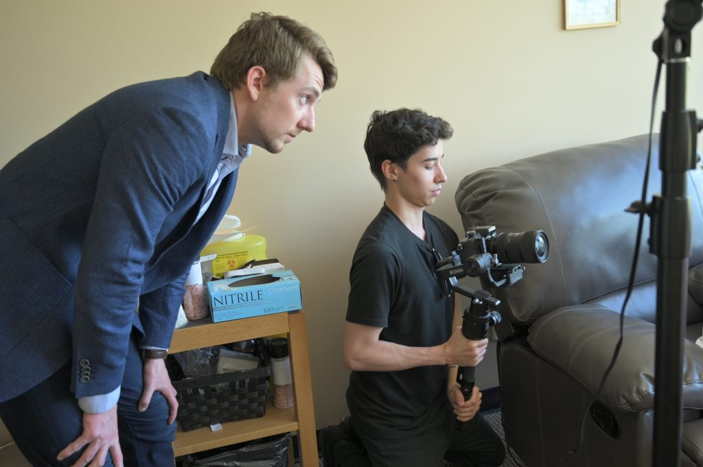 Keenan beavis and videographer filming a business commerical