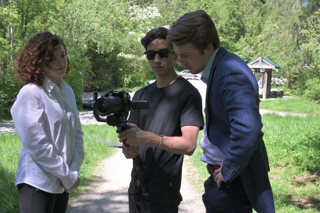 Keenan Beavis, Sydney Powers and videographer Aze at a business commercial shoot