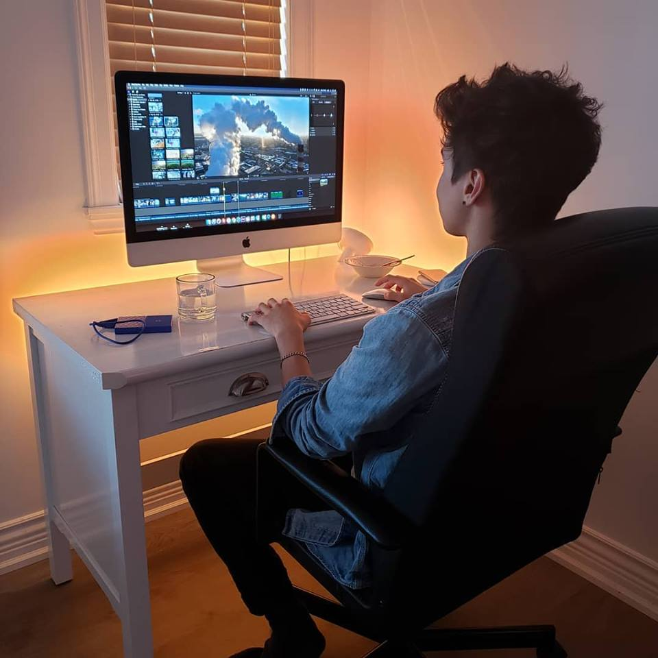 Videoographer Aze editing a corporate business video