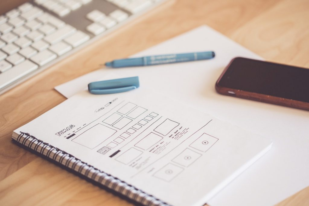 Creating a wireframe for a website by hand, using pen and paper.