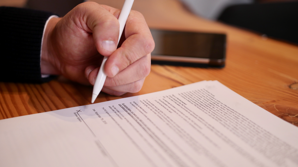 Man Signing a Video Production Contract